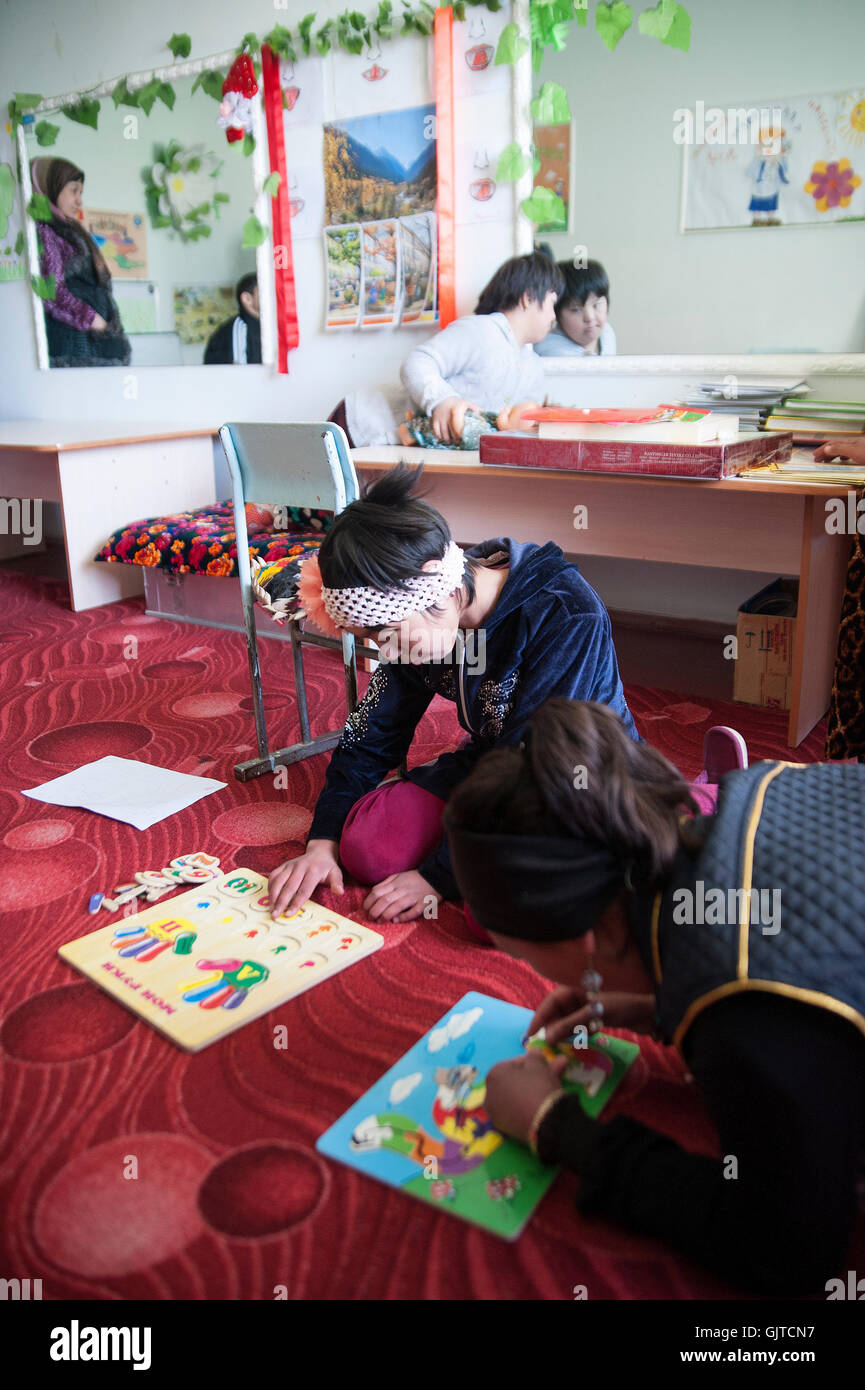 Jalalabat, Kyrgyzstan: In a center for mentally and physically disabled children,kids receive learning, speech, - Stock Image