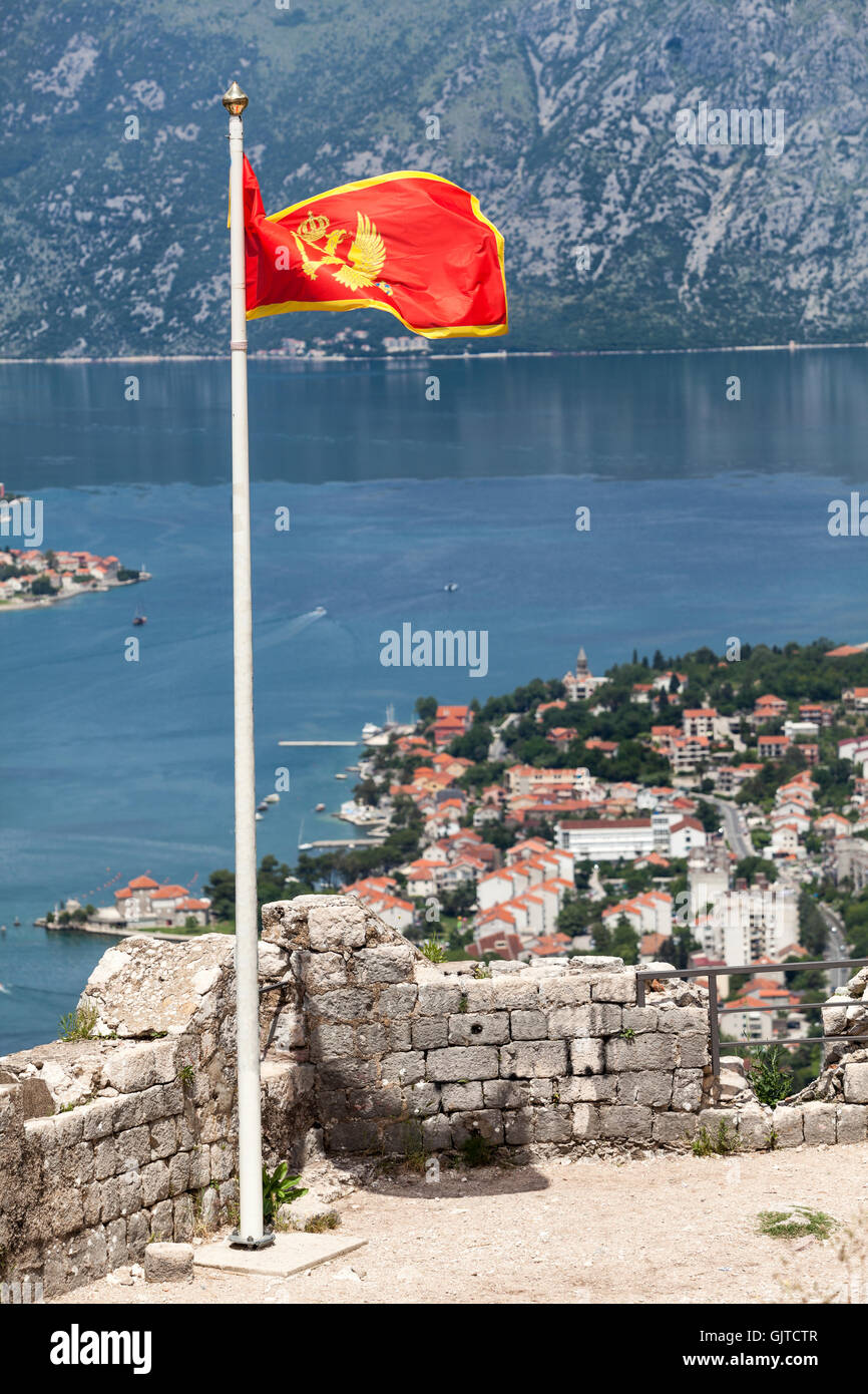 Pole with Montenegrin national flag on the fortifications of castle St. John (San Giovanni). Kotor, Montenegro Stock Photo
