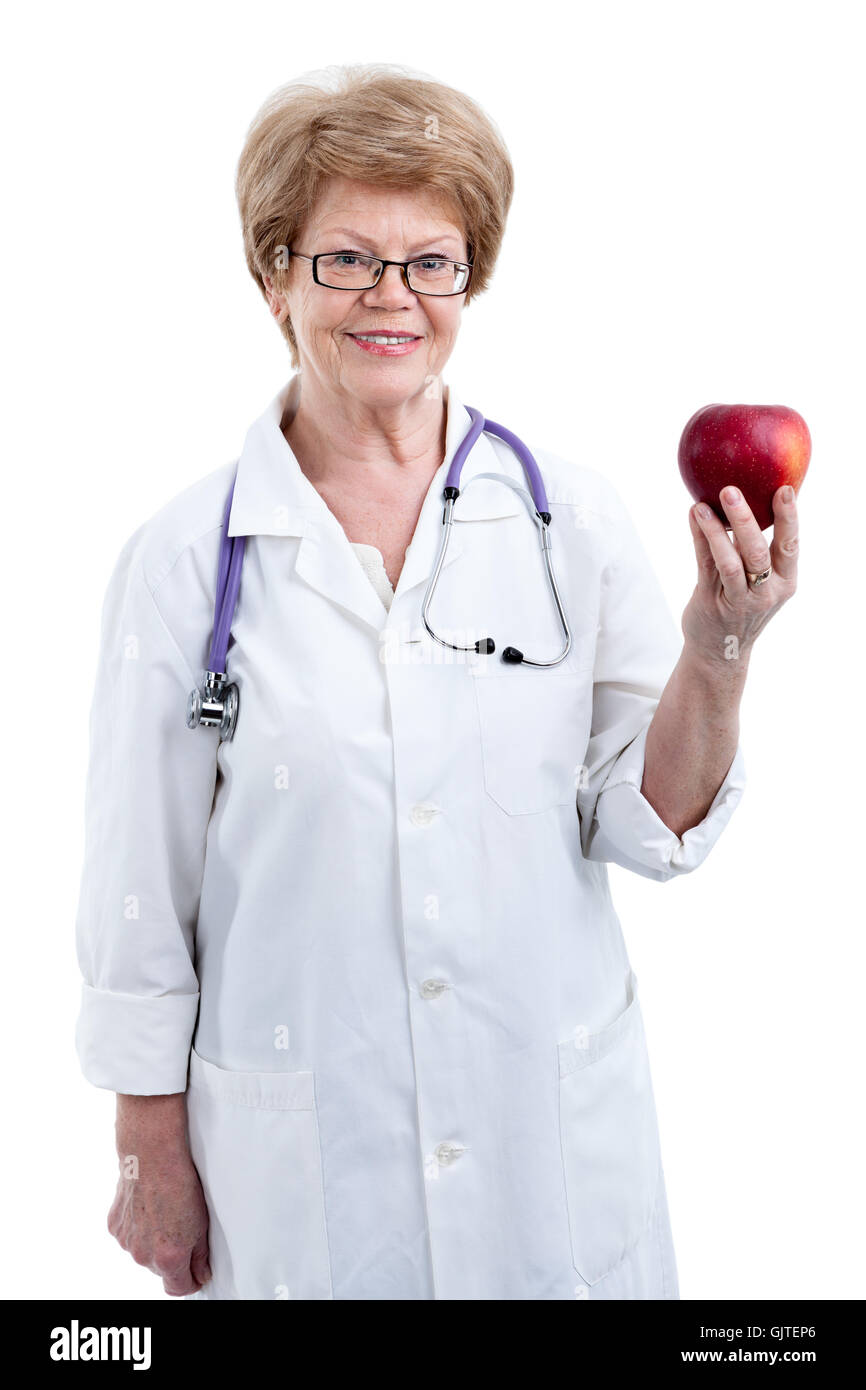 An elder doctor dietician showing red big apple in hand, isolated on white background - Stock Image