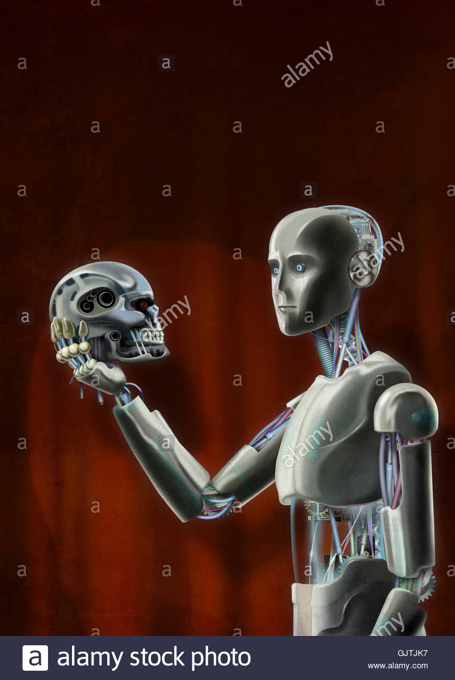 Android Hamlet looking at robot skull in hand - Stock Image