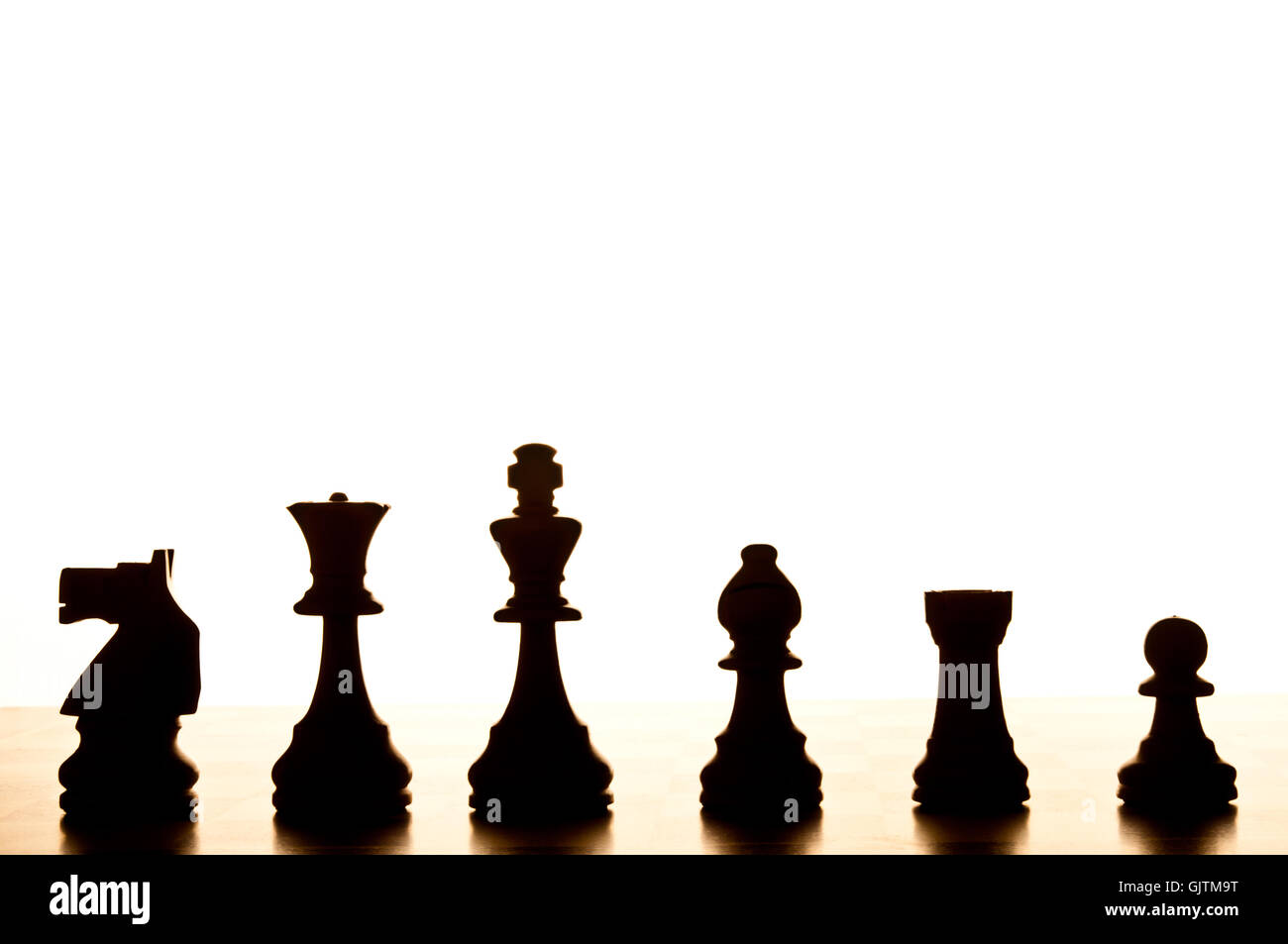 chess pieces in silhouette - Stock Image