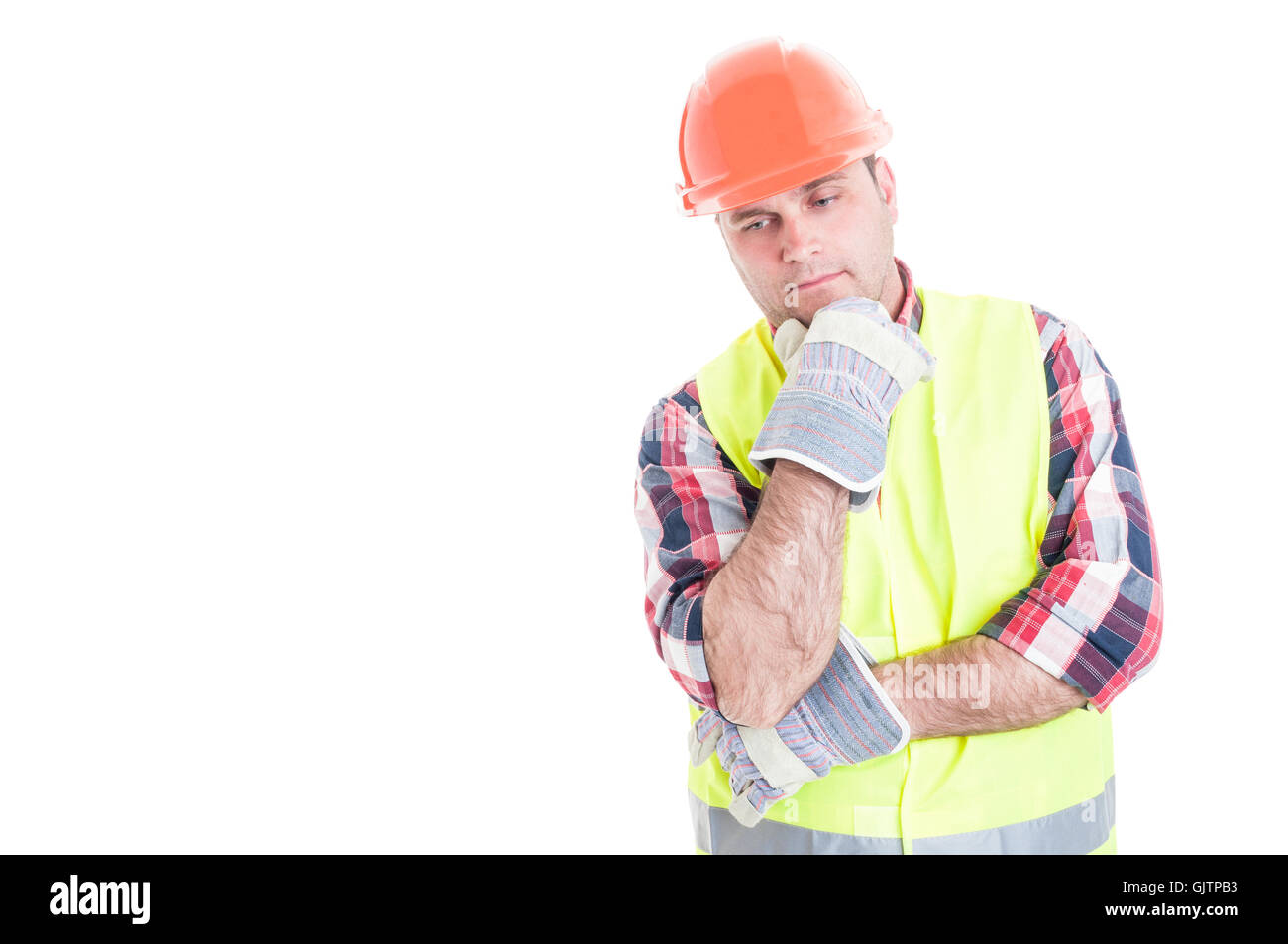 Thoughtful builder reflecting at something for his job isolated on white with advertising area - Stock Image