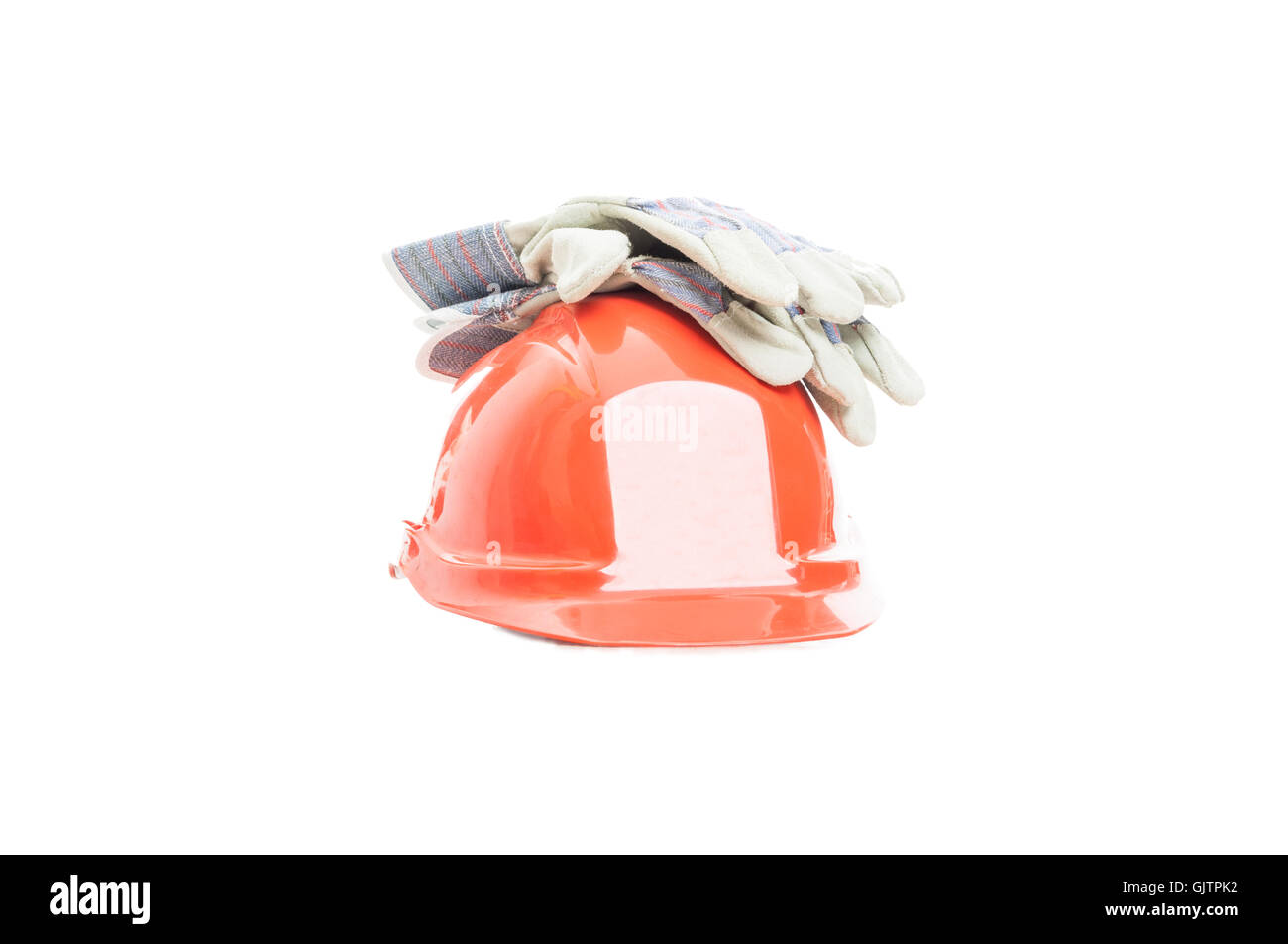 Safety gear kit with helmet and gloves for construction activity isolated on white background - Stock Image