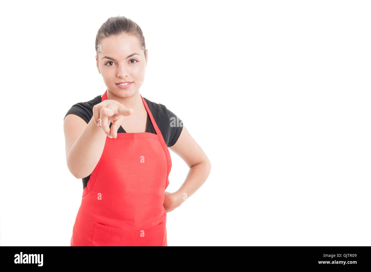 Attractive female supermarket seller supervising you or doing I'm wathcing you gesture isolated on white with - Stock Image