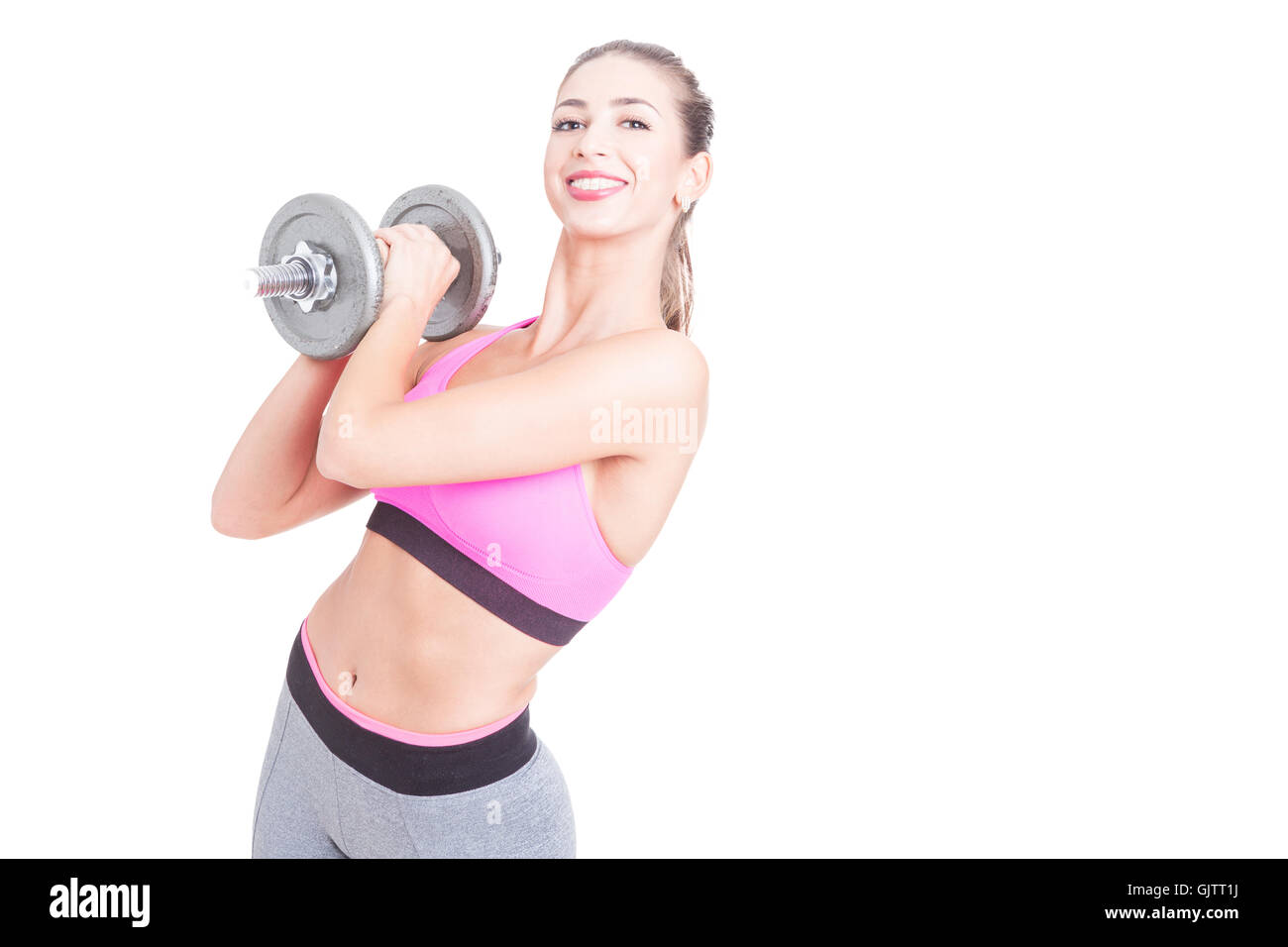 Girl working out holding heavy weight and smiling isolated on white background with copy text space - Stock Image