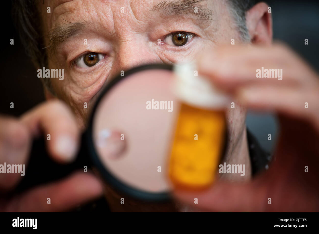 bottle magnify means - Stock Image