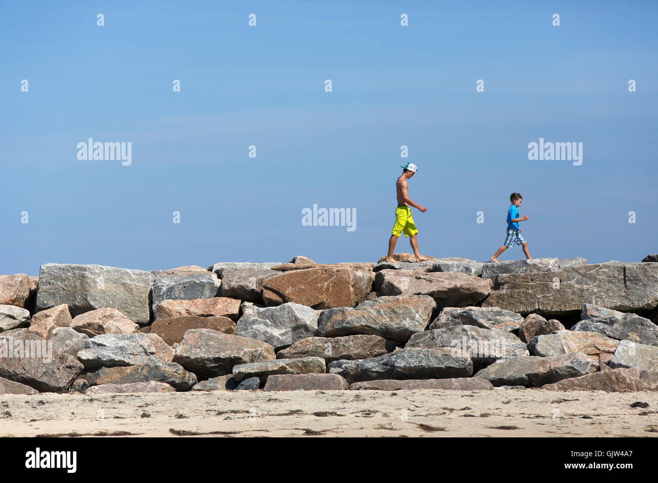 People on breakwater, Block Island, Rhode Island - Stock Image