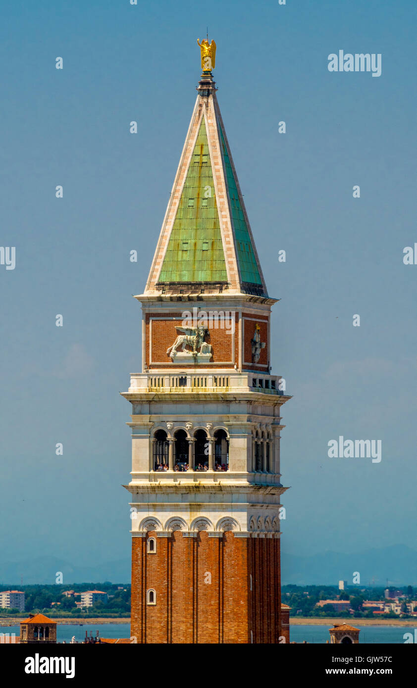 St Mark's bell tower pyramidal spire, at the top of which sits a golden weathervane in the form of the archangel - Stock Image