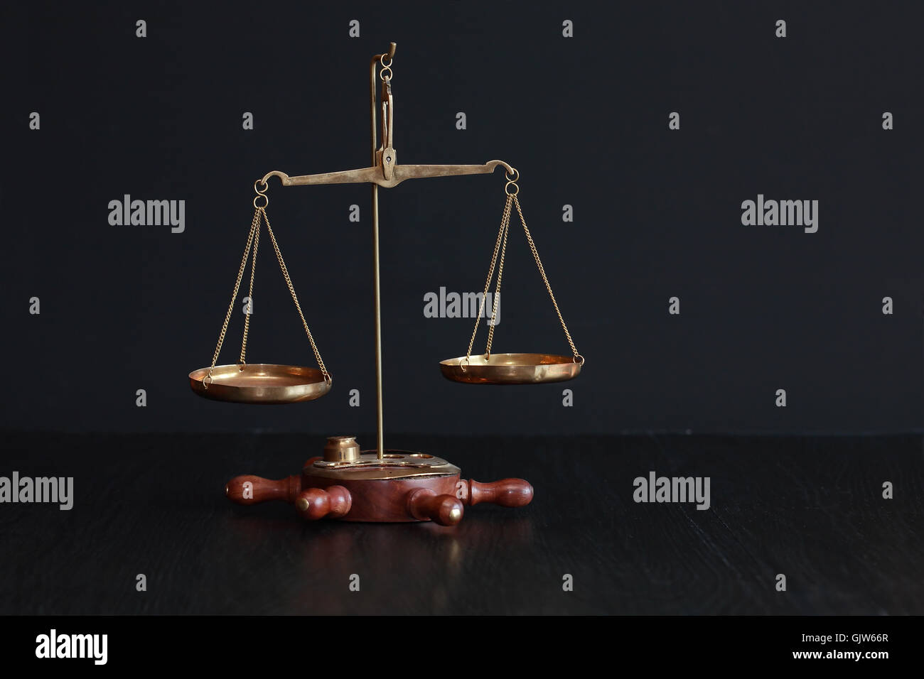 Old brass weight scale on black background with free space - Stock Image
