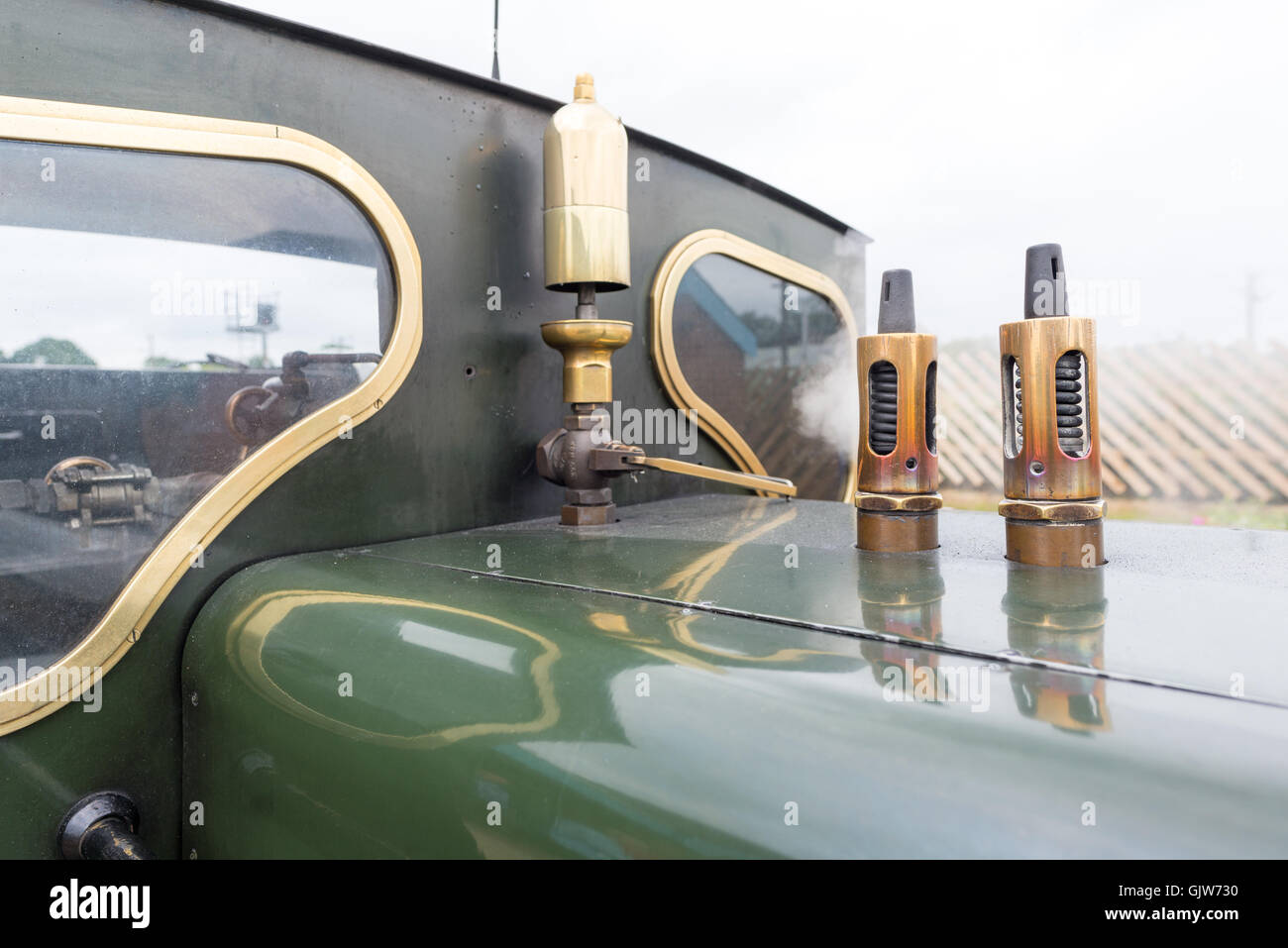 Whistle and steam vents on the top of the Bure Valley minimum gauge railway steam locomotive engine, Norfolk, UK. - Stock Image