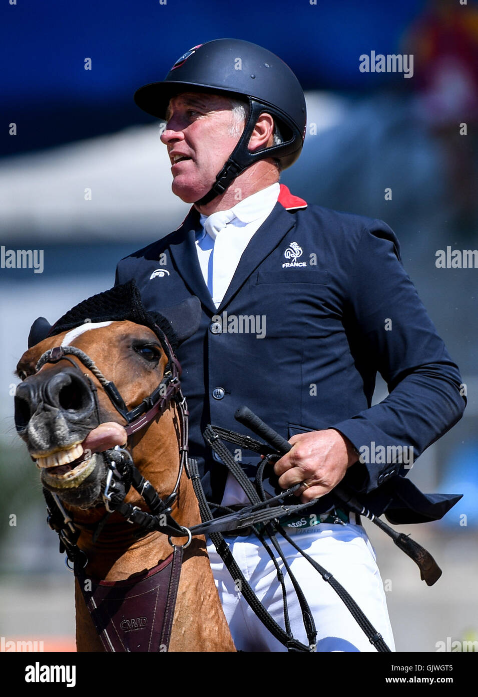 Rio De Janeiro, Brazil. 17th Aug, 2016. Roger Bost of France competes during the jumping team of equestrian at the - Stock Image