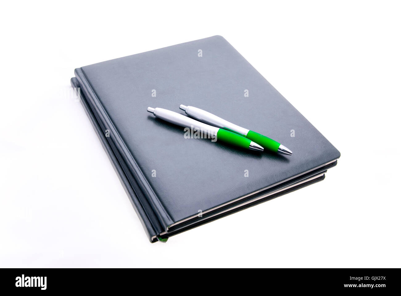 notepads and pens isolated Stock Photo