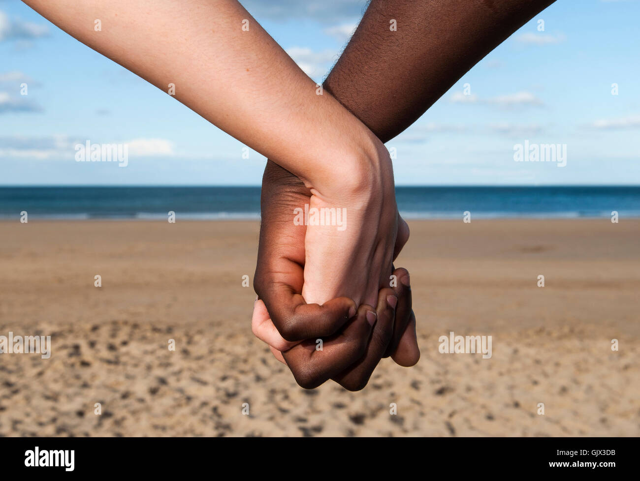 Interracial couples holding hands images 352
