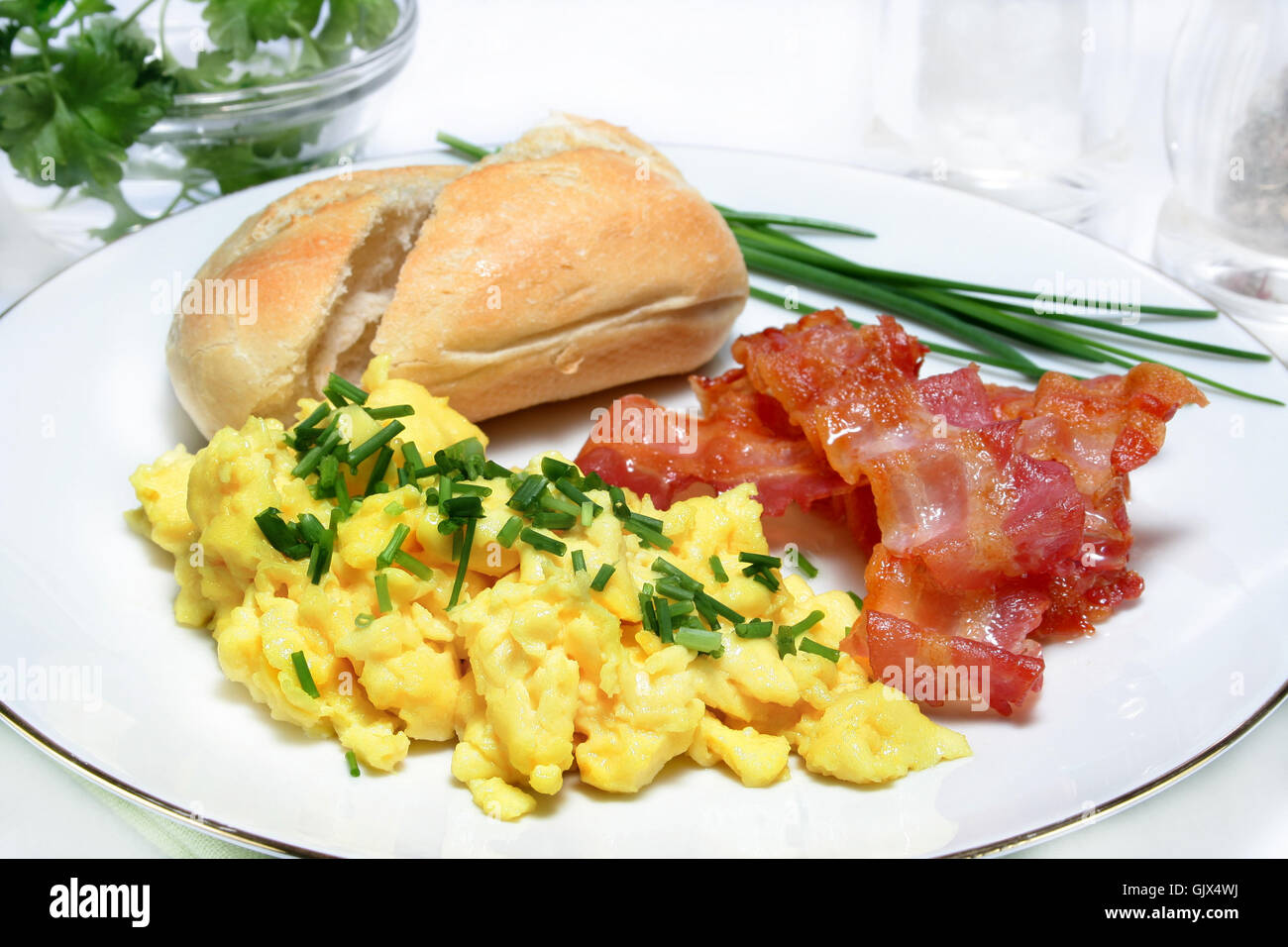 scrambled eggs with bacon - Stock Image