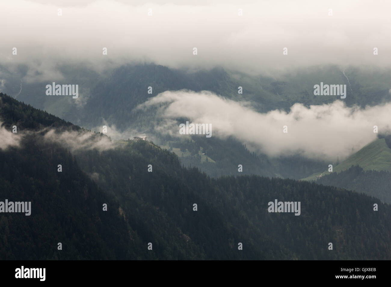 View of a mountain with clouds in a rainy day in Zillertal, Austria Stock Photo