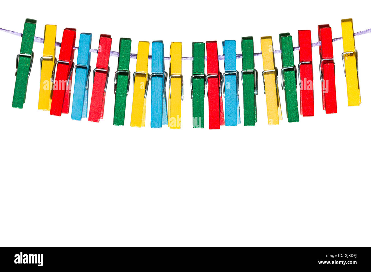 Colorful wooden clothespins on a line Stock Photo