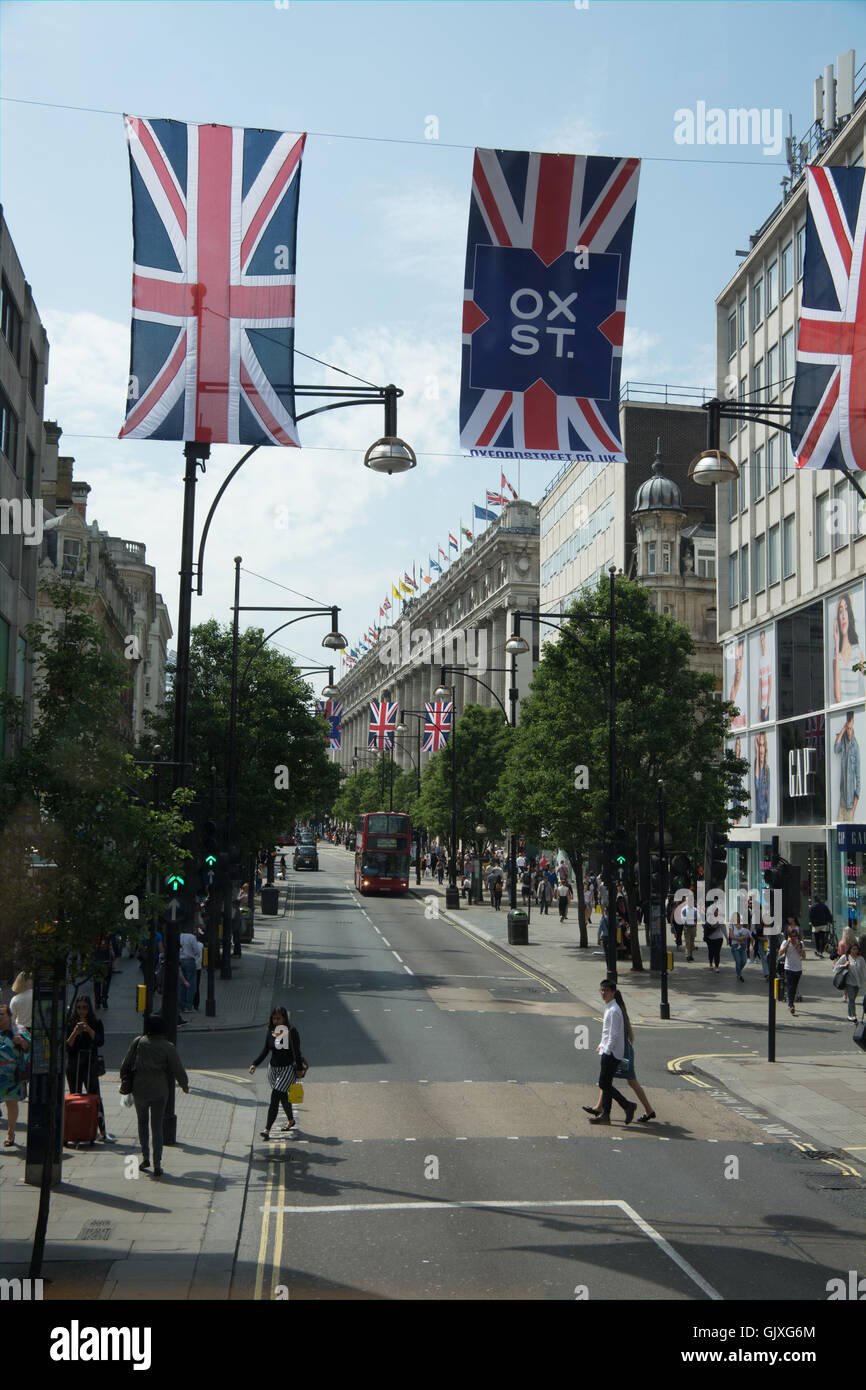 View from the top of a bus looking down Oxford Street, London towards Selfridges. Tourists and shoppers enjoy a - Stock Image
