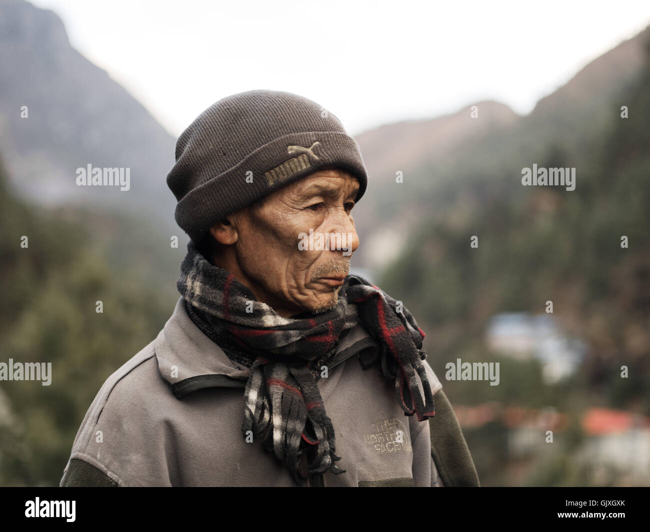 A Nepalese man journeying through Everest Base Camp - Stock Image