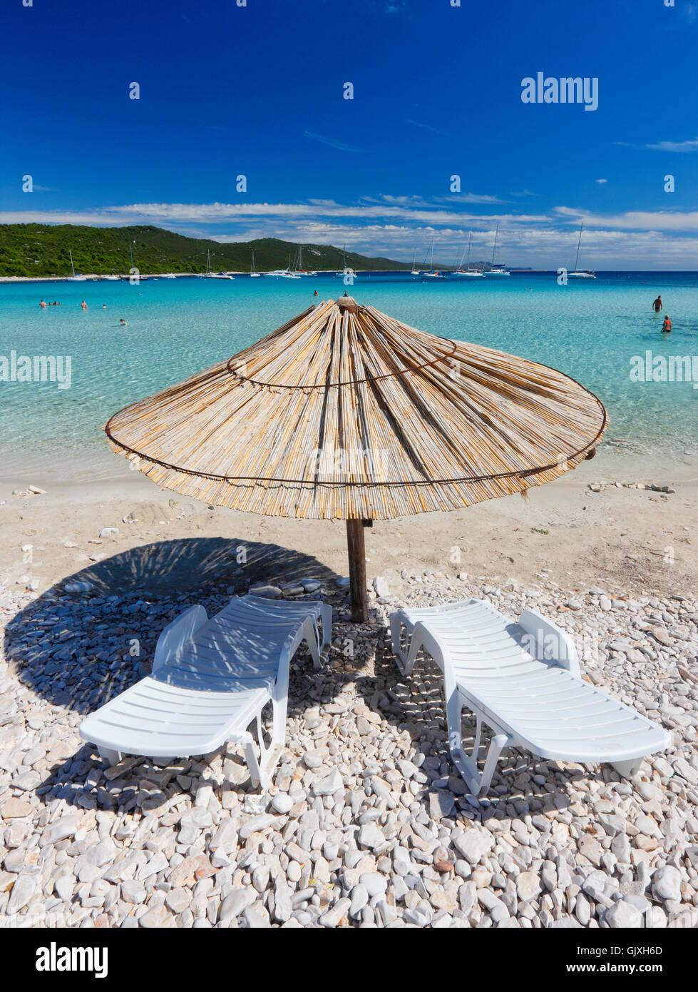 Straw umbrella on Sakarun beach, Dugi otok - Stock Image
