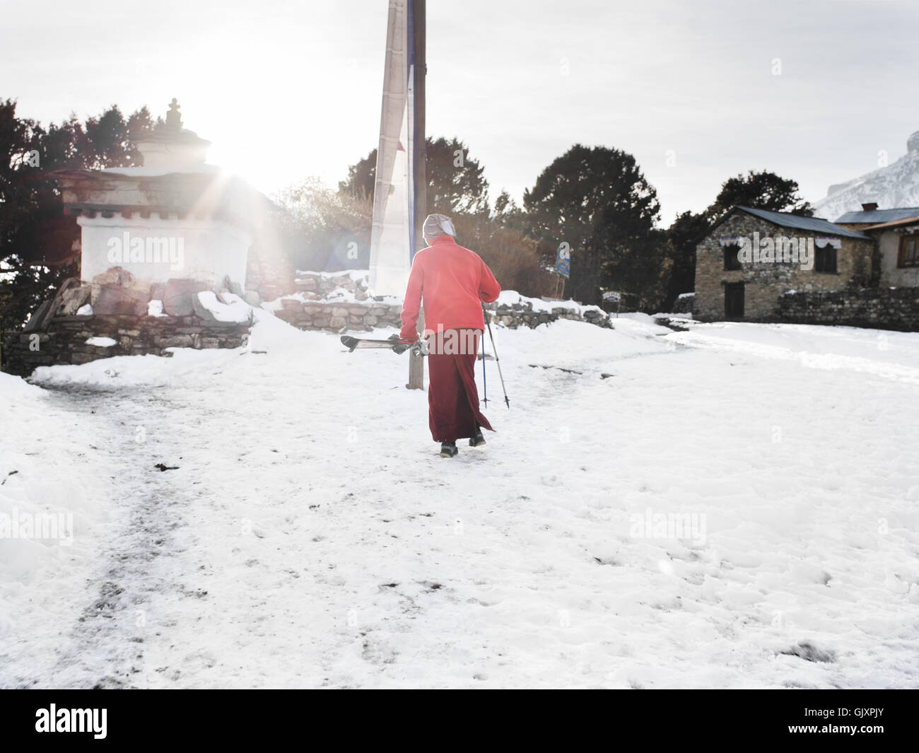 A monk skis in the Tengboche Monastery in Nepal's Everest Base Camp - Stock Image