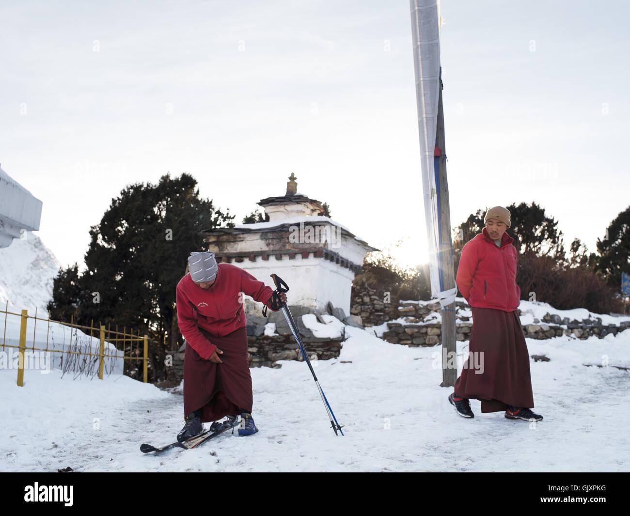 Monks ski in a monastery near Tengboche, Nepal - Stock Image