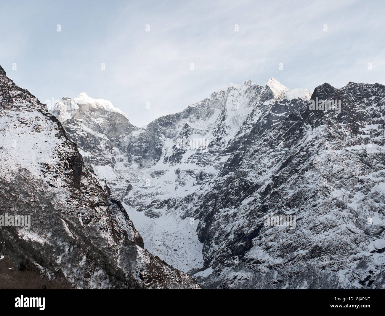Jagged snow capped mountains near Tengboche, Nepal in Everest Base Camp - Stock Image