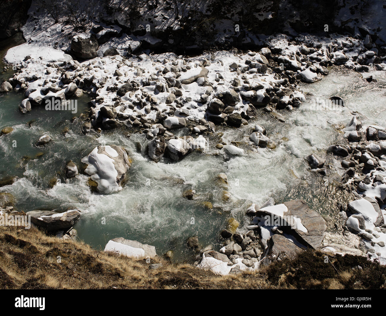 Rushing Himalayan mountain water in Nepal's Everest Base Camp near Tengboche - Stock Image
