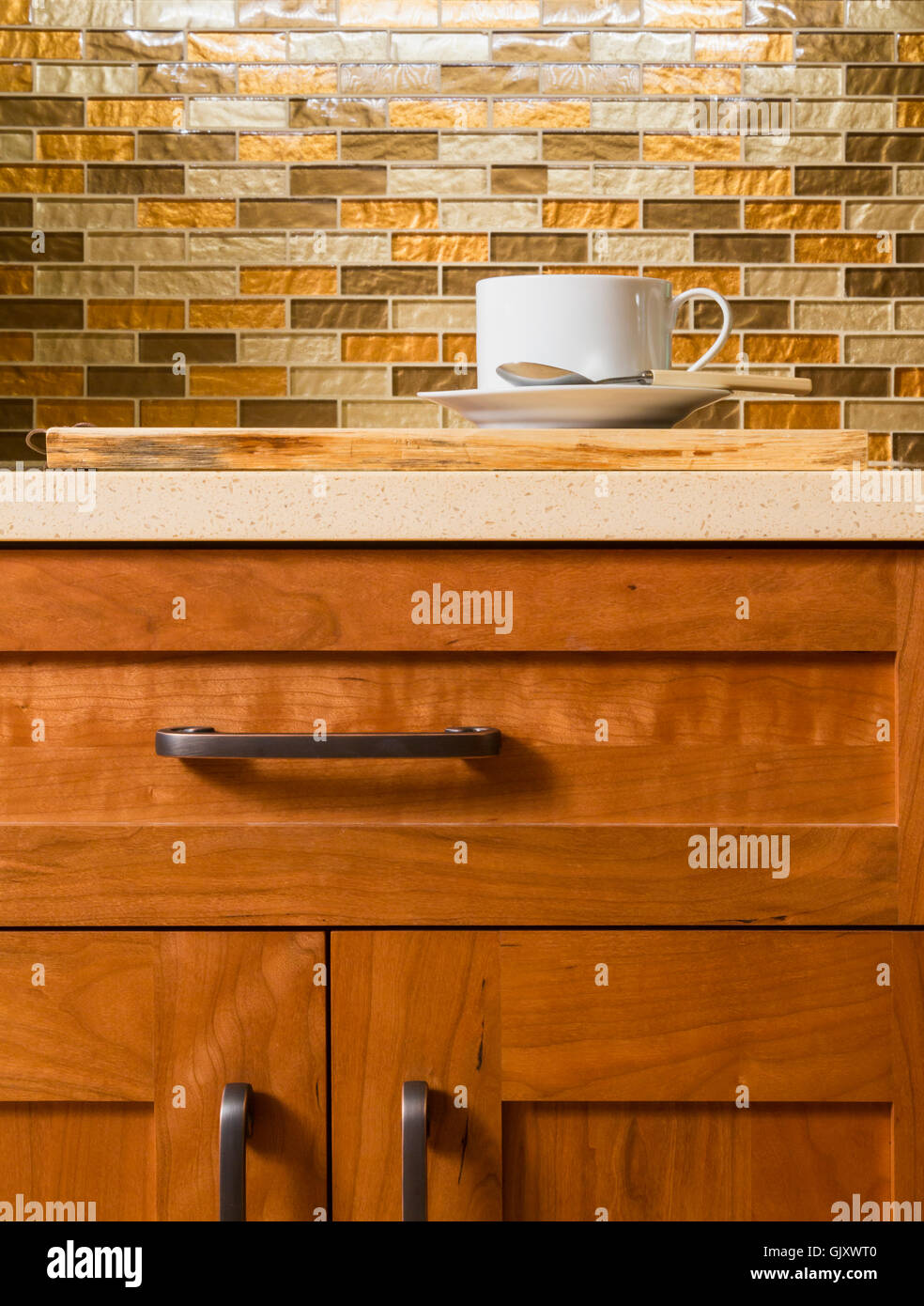 High quality wood cabinets with bronze cabinet hardware & glass tile ...