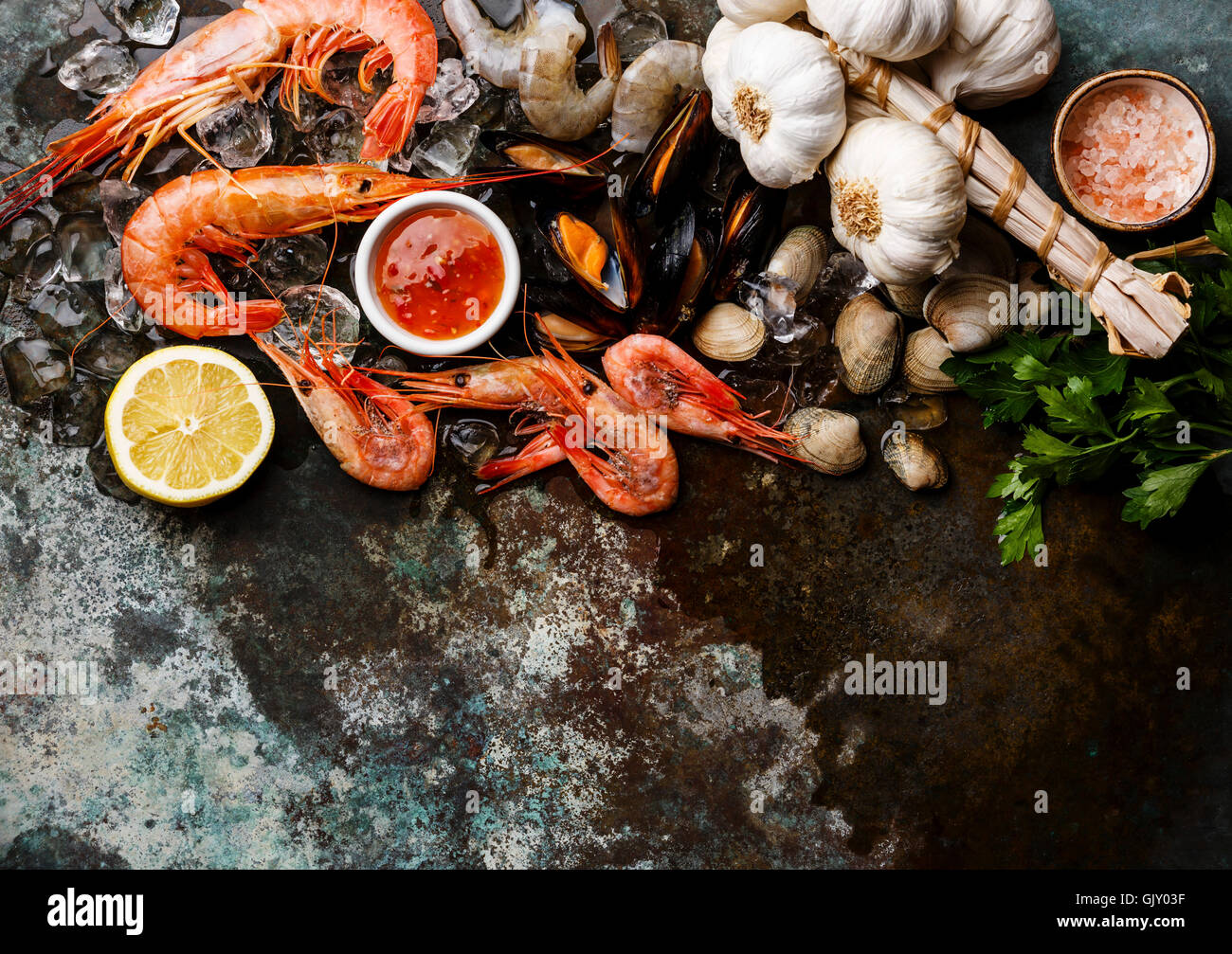 Seafood copy space Background with fresh raw Mussels, Clams, Vongole, Prawns, Shrimps and Ingredients - Stock Image