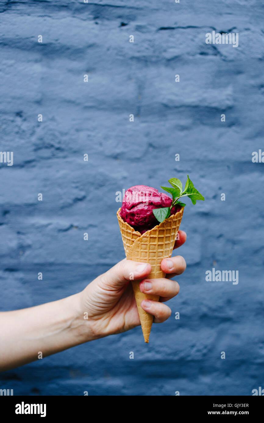 Cherry ice cream on a grey background - Stock Image