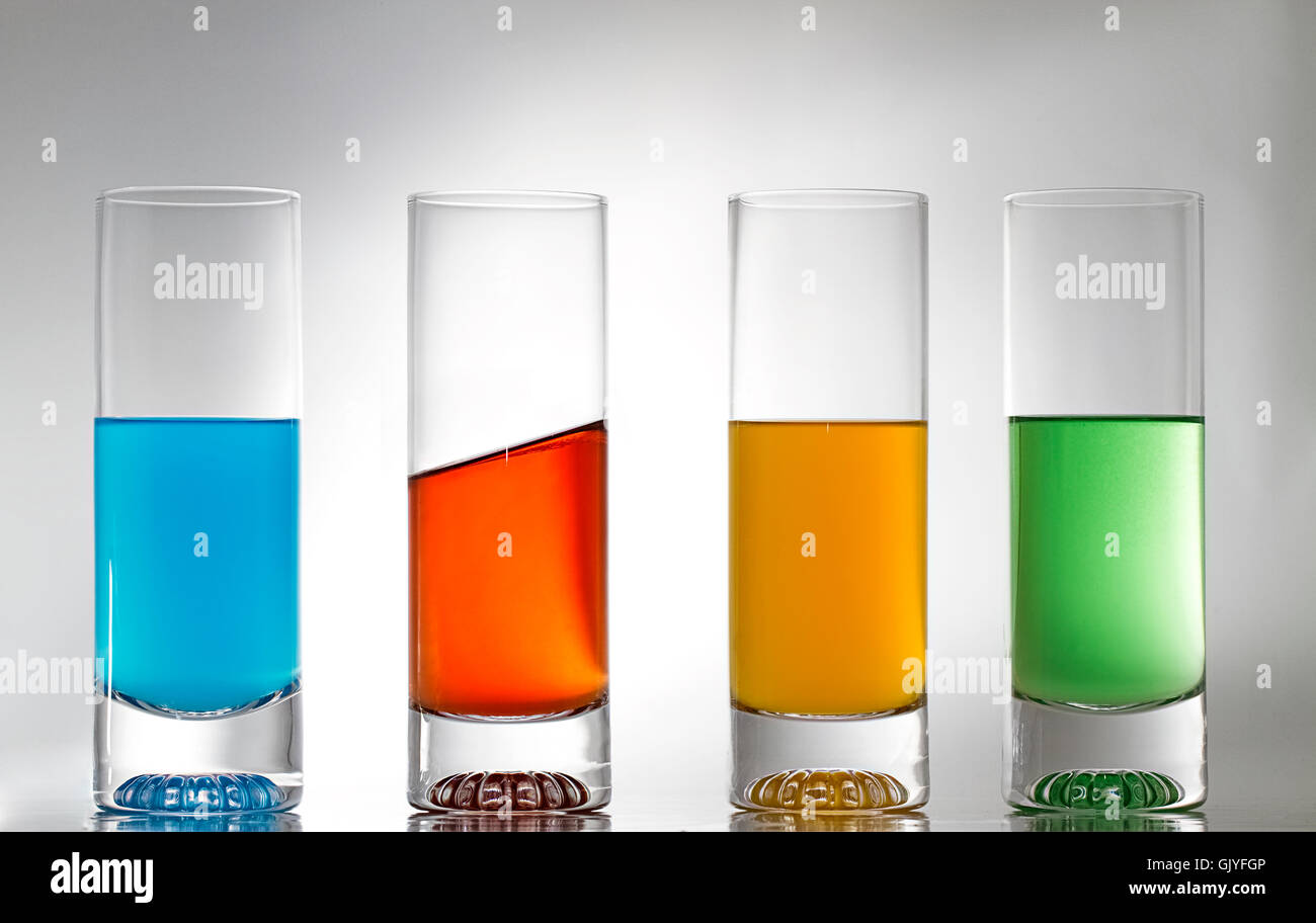 four glasses one diagonally - Stock Image
