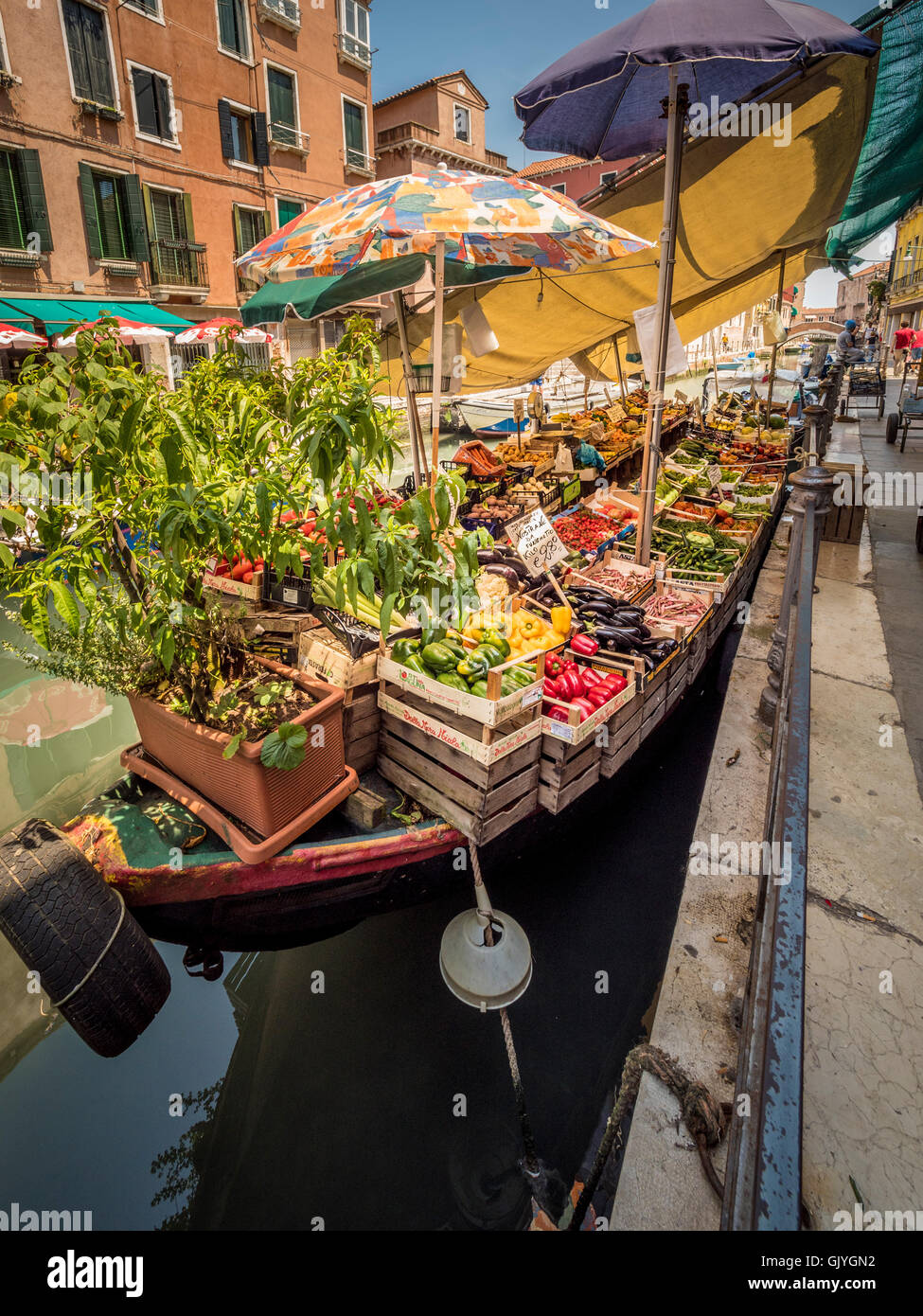 Moored barge selling fruit and vegetables, on the Rio de S. Ana, Venice. - Stock Image
