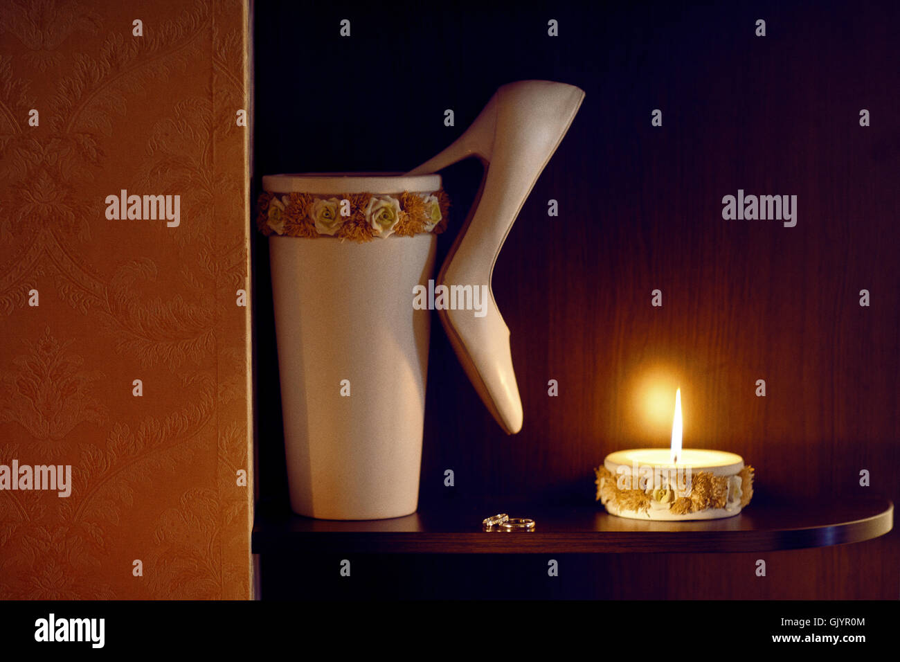 candle, shoe and rings - Stock Image