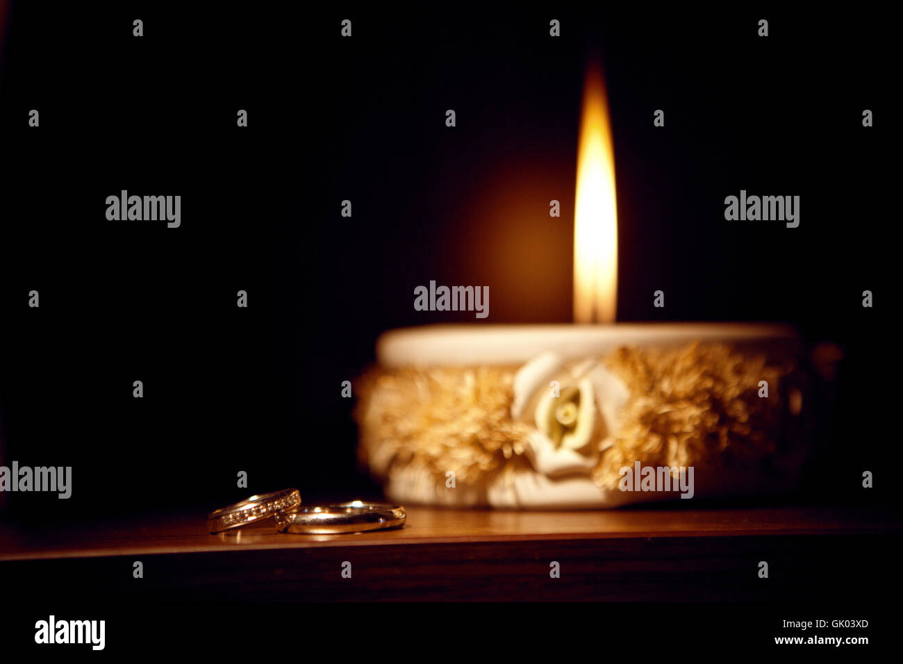candle and rings - Stock Image