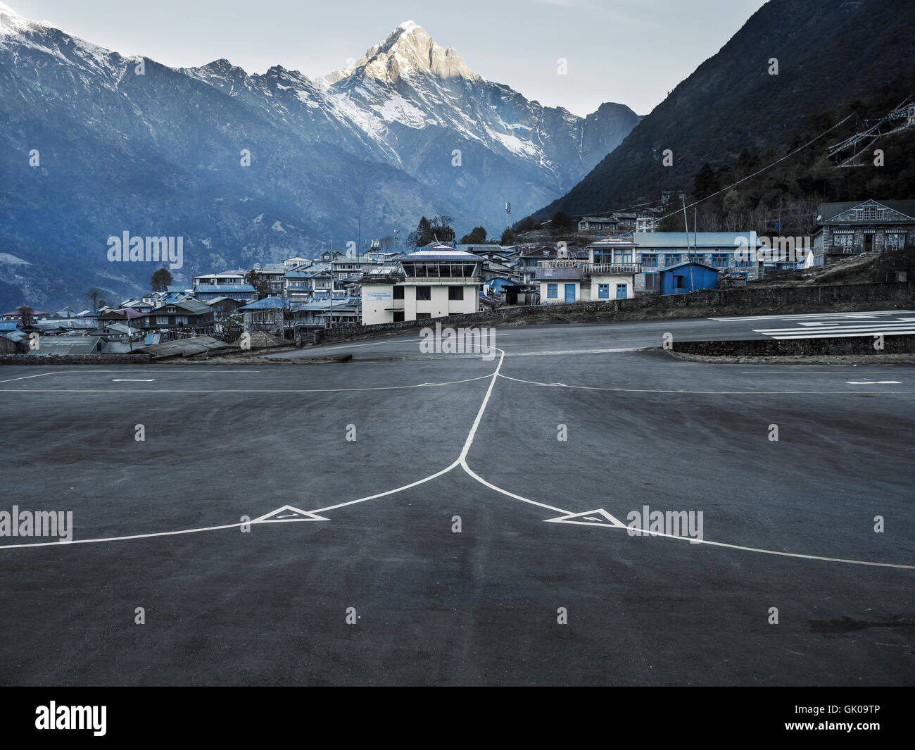 A runway at the Lukla Airport in Lukla, Nepal, which is a gateway to Everest Base Camp. - Stock Image