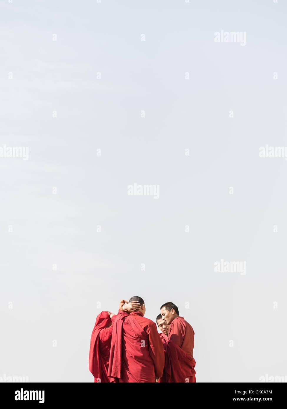 Monks converse in Lukla, Nepal - Stock Image