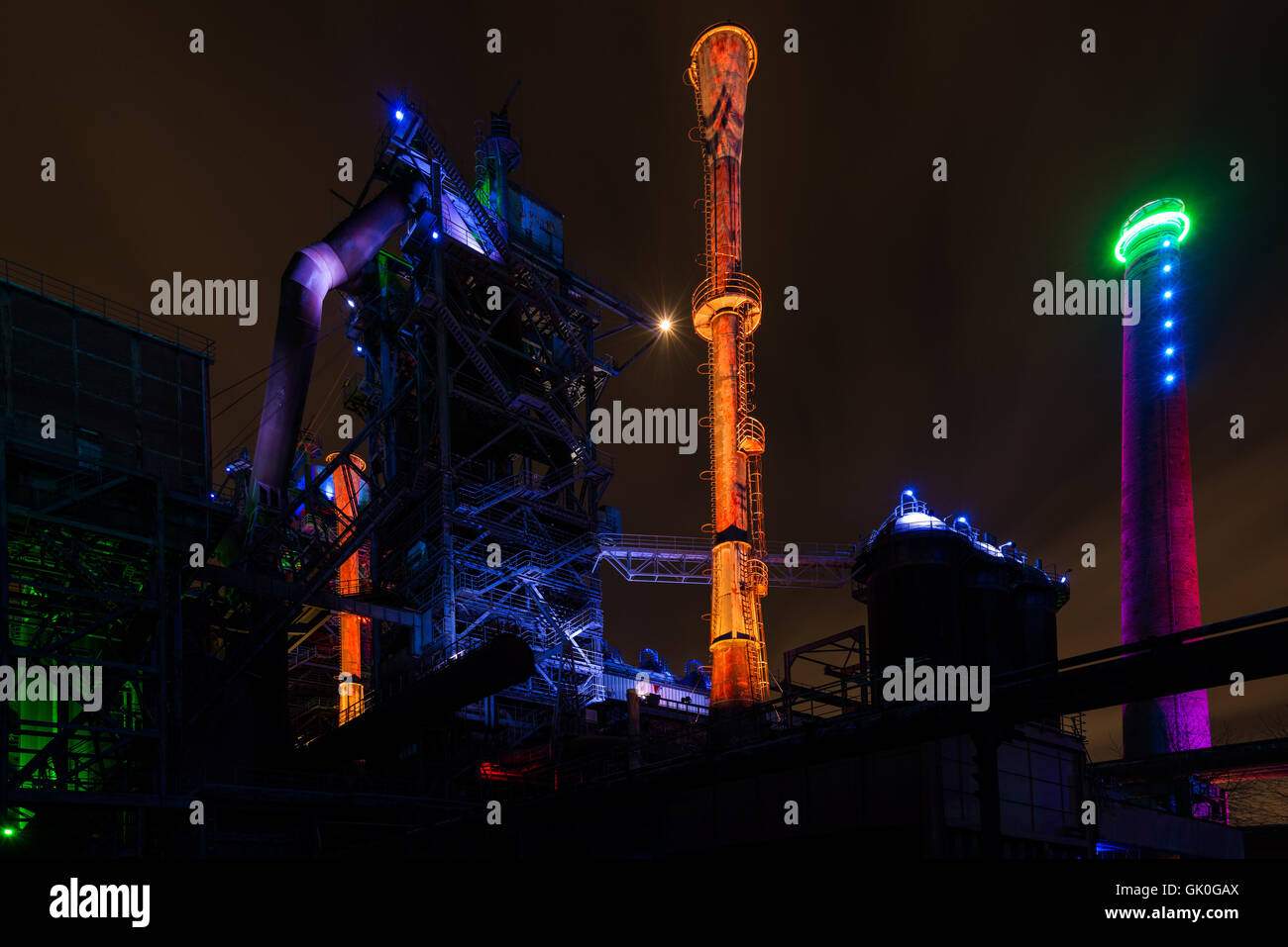 Night shot of Landschaftspark Nord, old illuminated industrial ruins in Duisburg, Germany - Stock Image