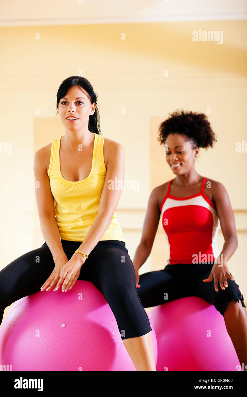 two women with exercise ball in studio - Stock Image