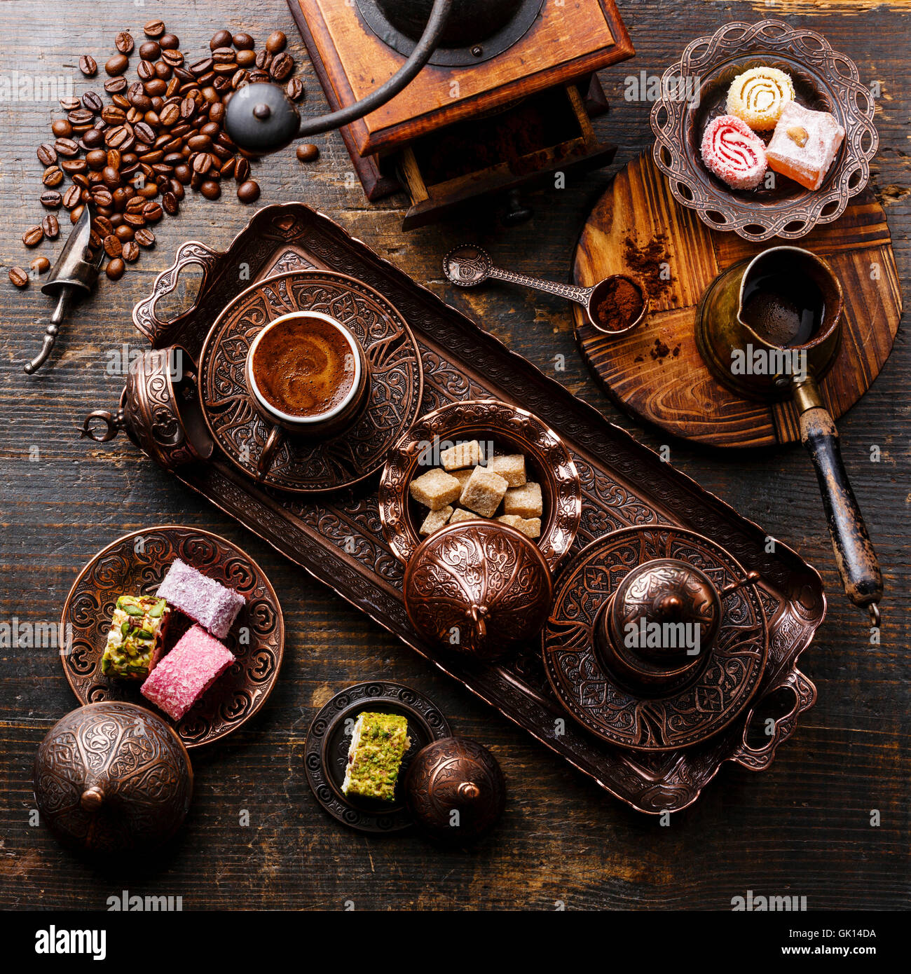 Coffee-east and Turkish Delight on copper tray on wooden background - Stock Image