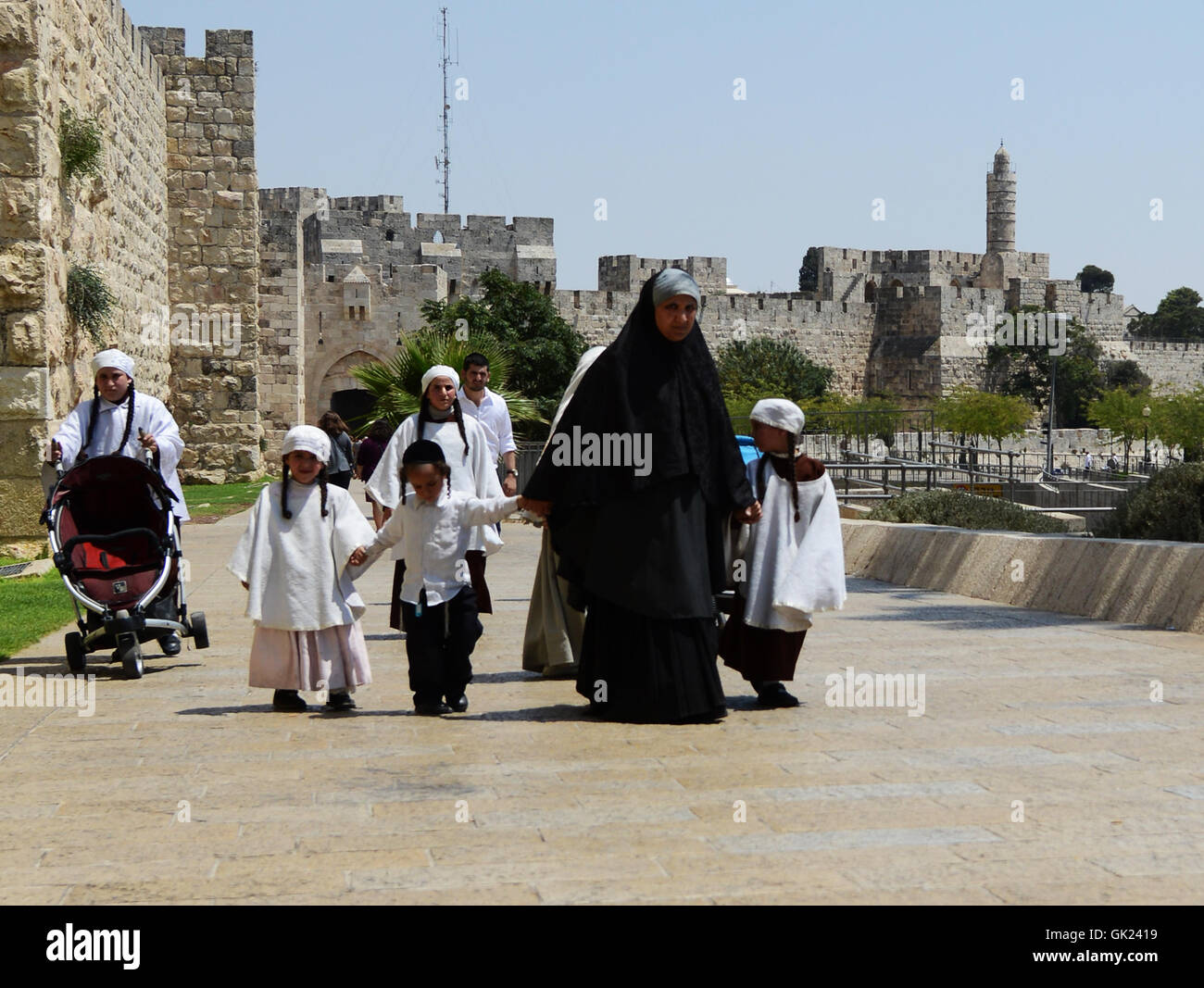 Ultra Orthodox Jewish woman with her kids. These women are dressed in a Taliban style, full body covered. Stock Photo