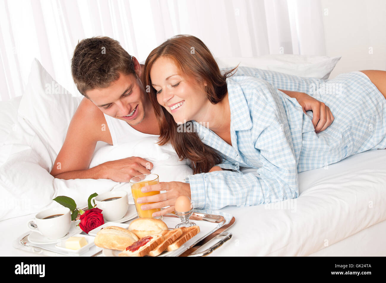 bed delighted unambitious - Stock Image