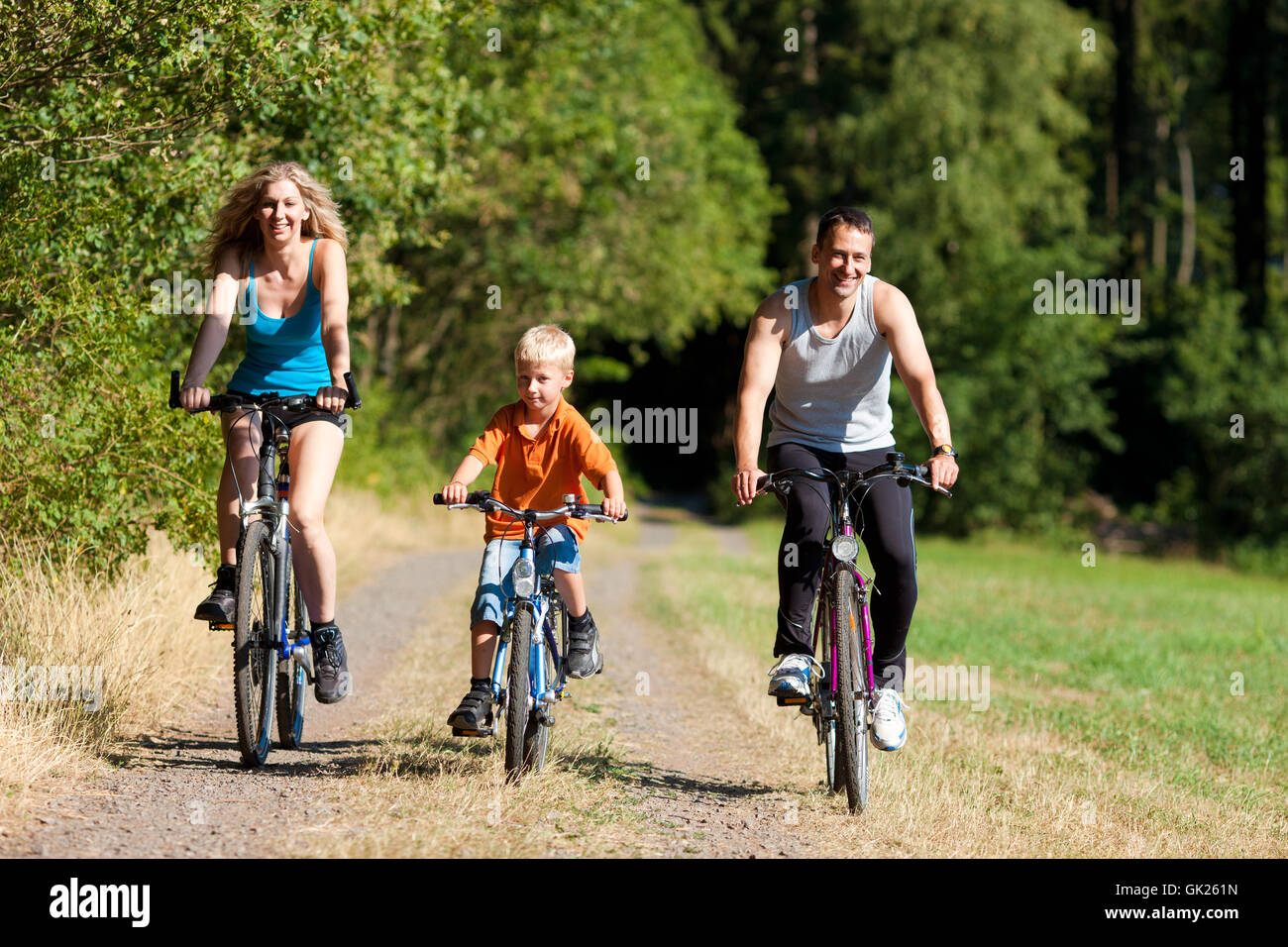 family rides a bike as a sport - Stock Image