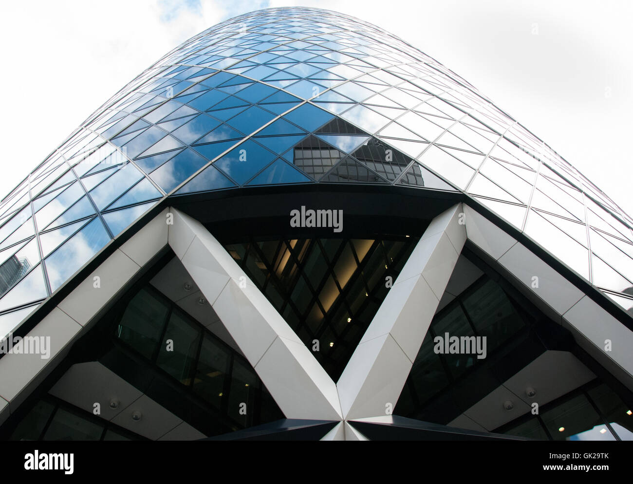 London, England UK. 07 march, 2016. The skyscraper 30 St Mary Axe known as «The Gherkin» seen from street level Stock Photo