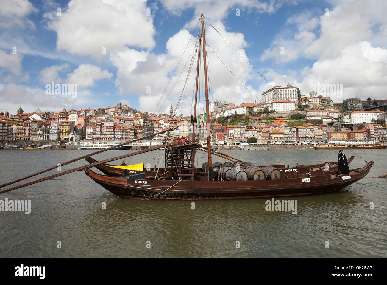 City of Porto in Portugal, Rabelo traditional Portuguese cargo boat with Port wine barrels on Douro river and old Stock Photo