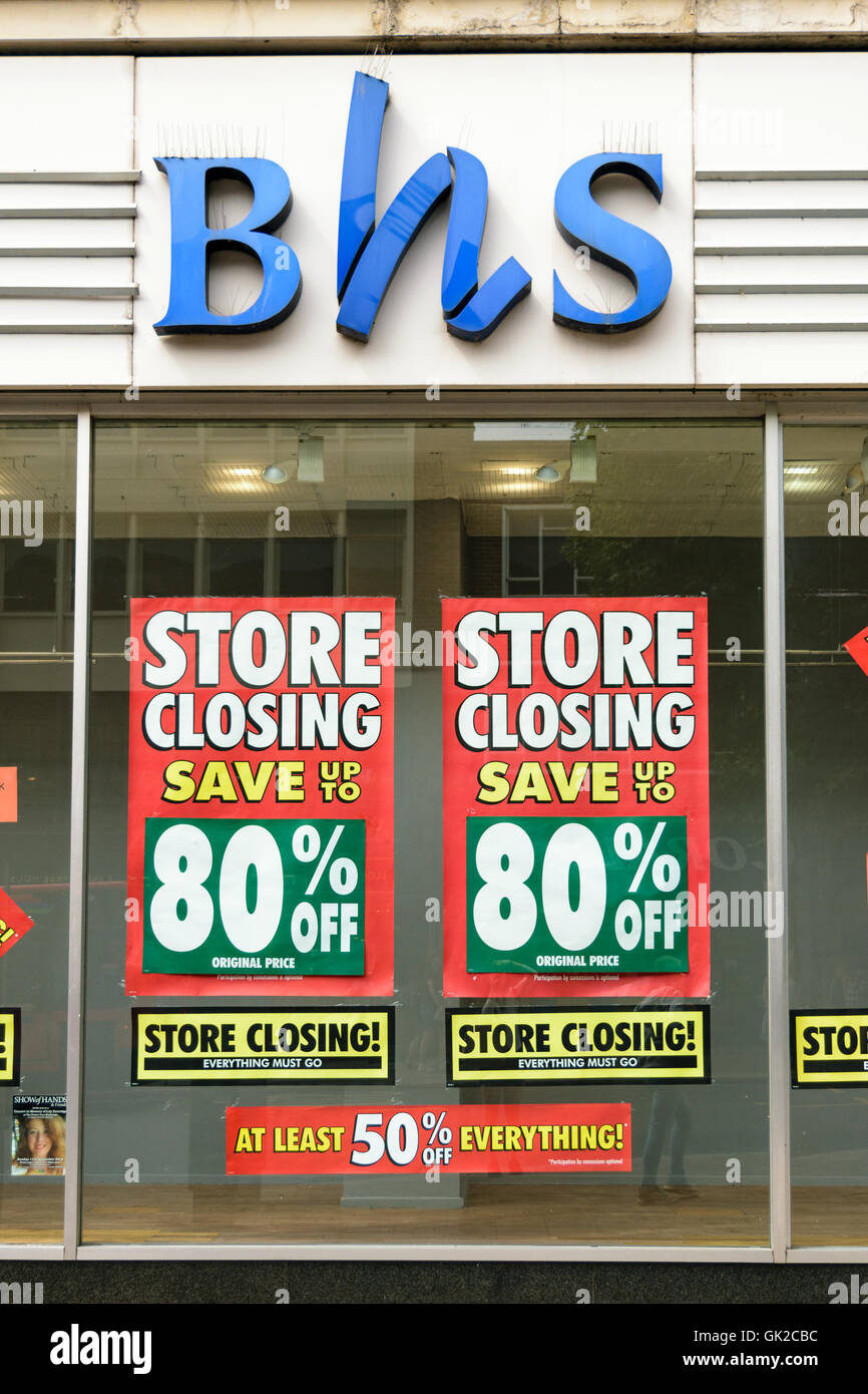 Exeter, Devon, United Kingdom - August 17, 2016: Store closing signs in the window of BHS (British Home Stores) - Stock Image