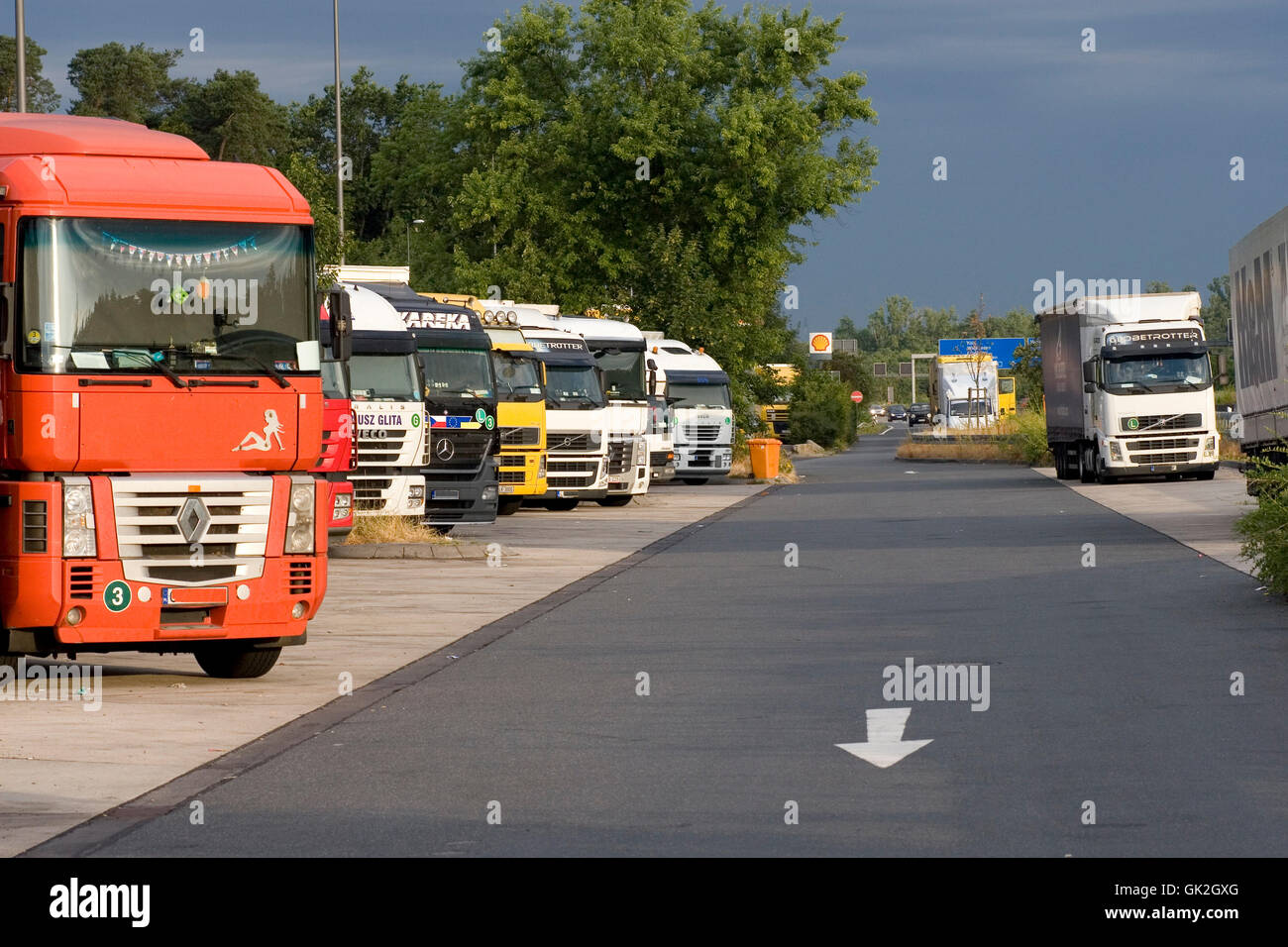 trucks on the motorway service station weiskirchen on the a3 (no pr) - Stock Image