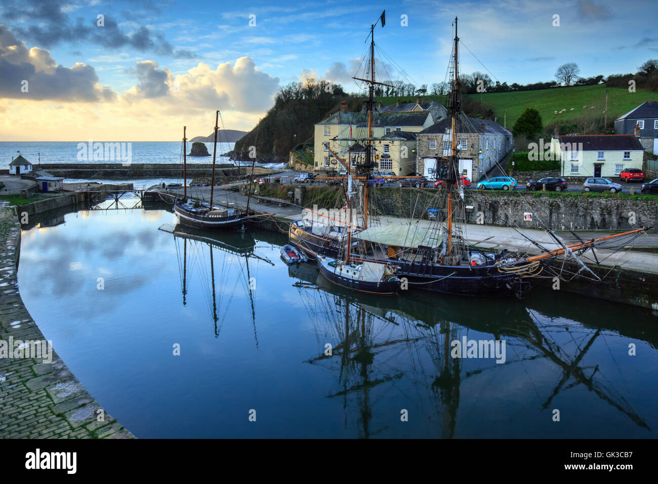 Tall Ships captured at sunrise in Charlestown Harbour - Stock Image