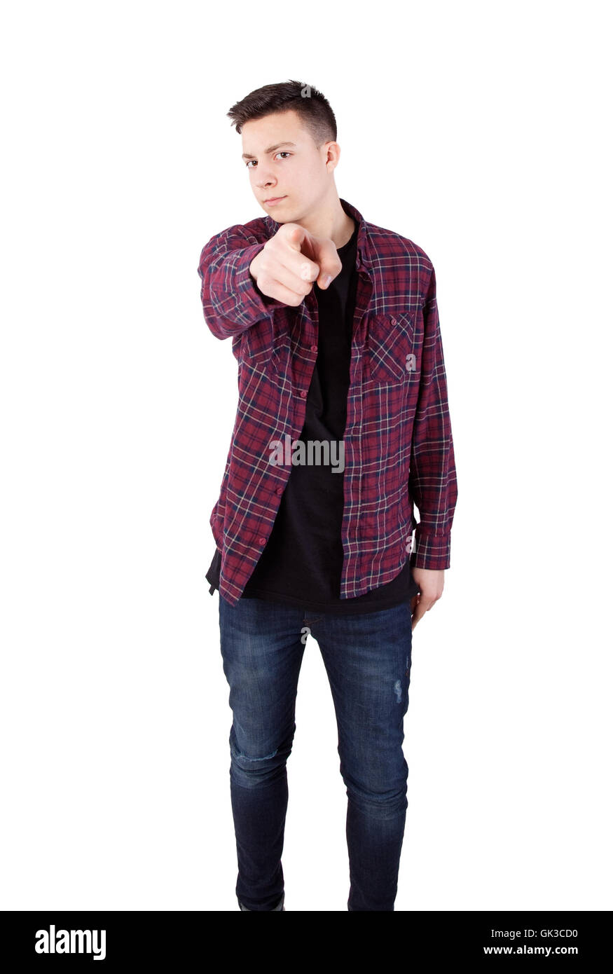 angry boy pointing his finger against somebody - Stock Image