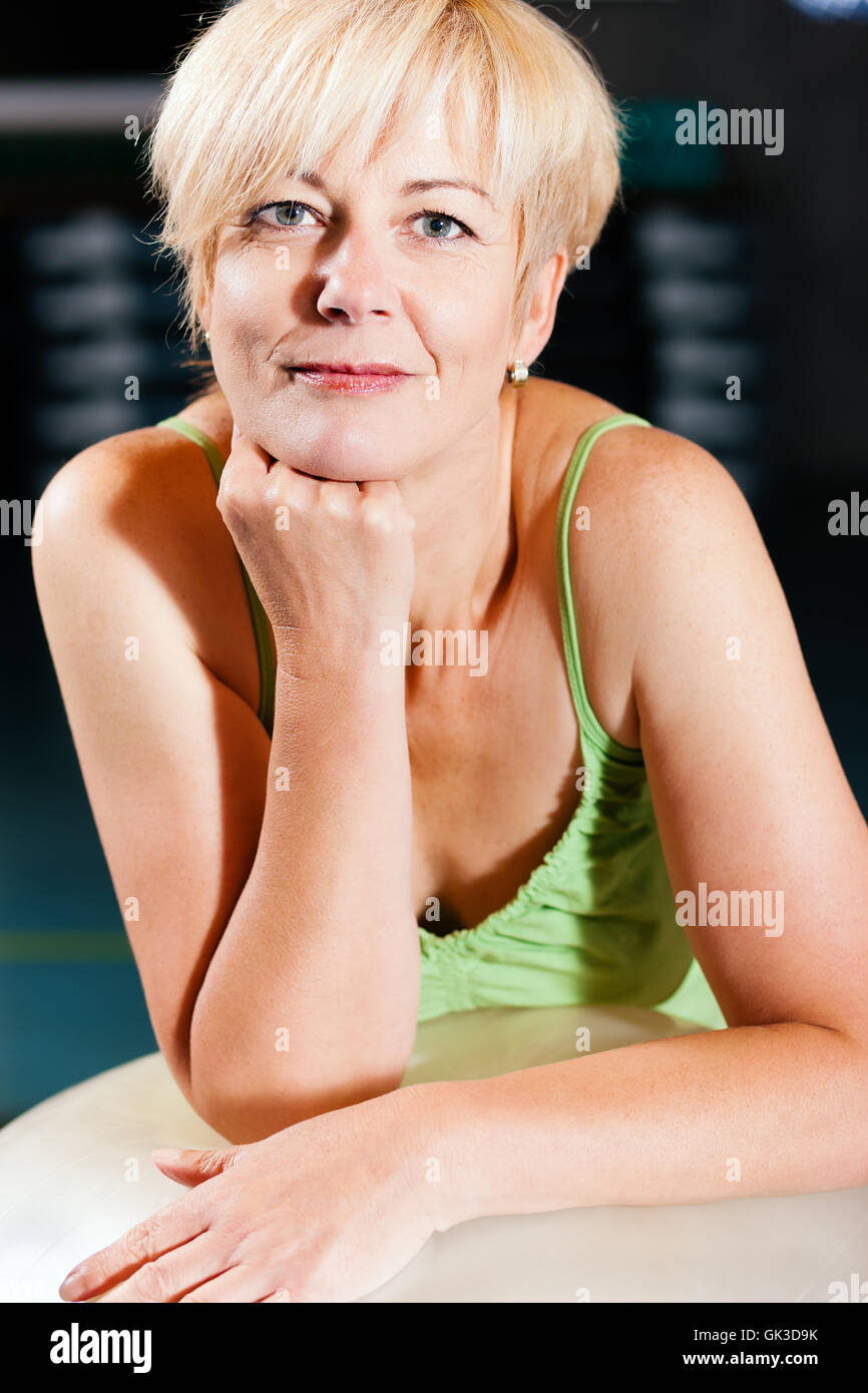 elderly woman with exercise ball - Stock Image