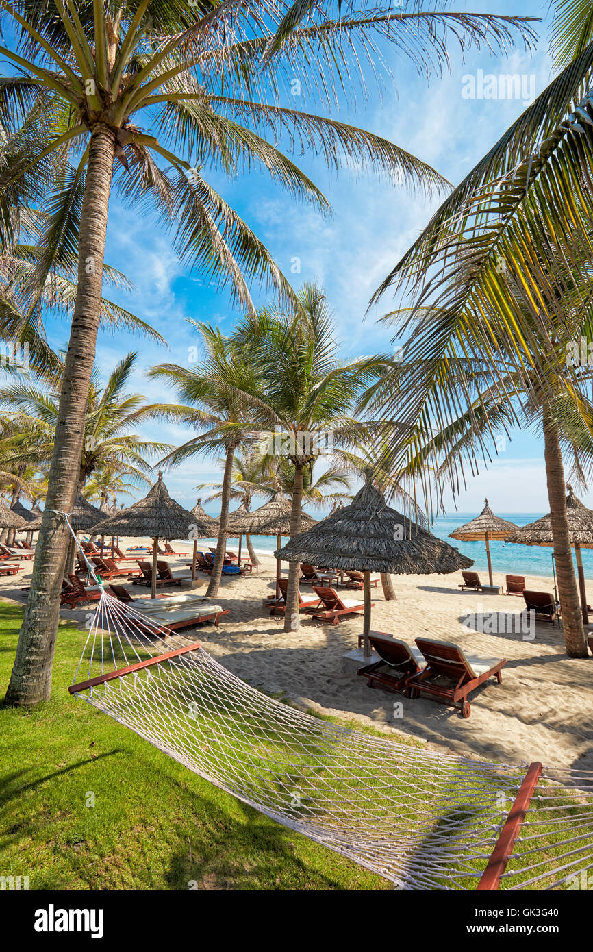 Hammock in Palm Garden Beach Resort. Cu Dai beach, Hoi An, Quang Nam Province, Vietnam. - Stock Image